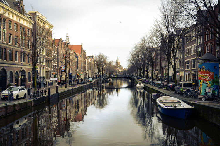 Amsterdam Canal in January. Amsterdam Amsterdam Canal Amsterdam Centraal Amsterdamcity Architecture Bike Boat Bridge Building Exterior Built Structure Canal City Neon Lights Night Outdoors Red Light District Reflection Reflection River Riverside Sky Travel Destinations Tree View Water
