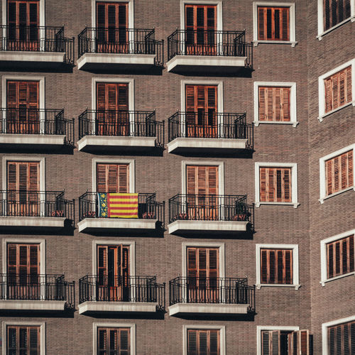 Valencian flag on a balcony in the city center of Valencia, Spain. Patriotism SPAIN València Apartment Architecture Backgrounds Balcony Building Building Exterior Built Structure City Day Flag Full Frame House In A Row Low Angle View No People Outdoors Pattern Repetition Residential District Side By Side Street Window