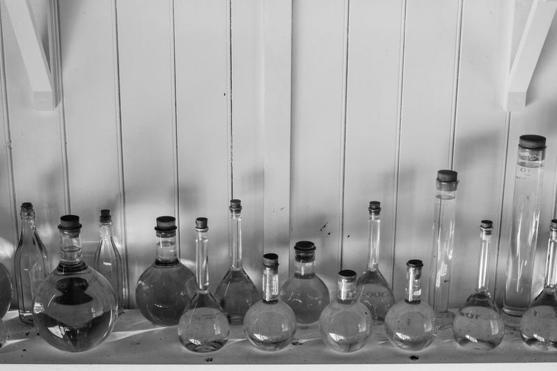 View of empty glass bottles on wall