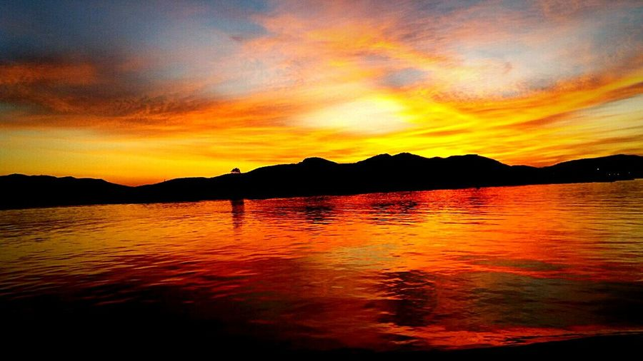 Sunset Mountain Water Scenics Outdoors No People Nature Reflection Travel Destinations Lake Tranquility Landscape Beauty In Nature Sky Vacations Tree Day Flamingo Sun Nature Sunbeam 2017 Beauty In Nature Tranquility Taking Photos