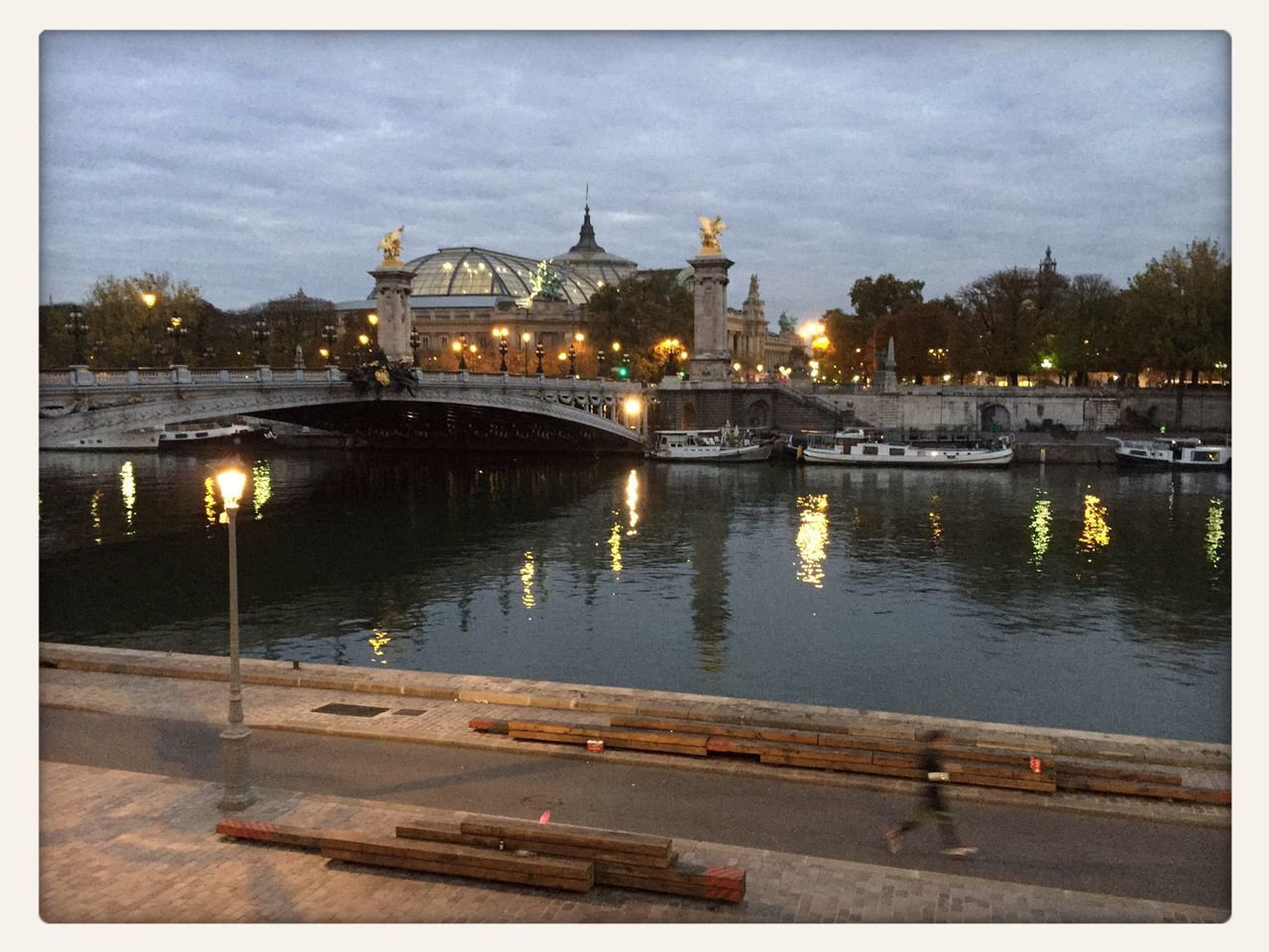 Pont Alexandre Iii Over River Against Cloudy Sky
