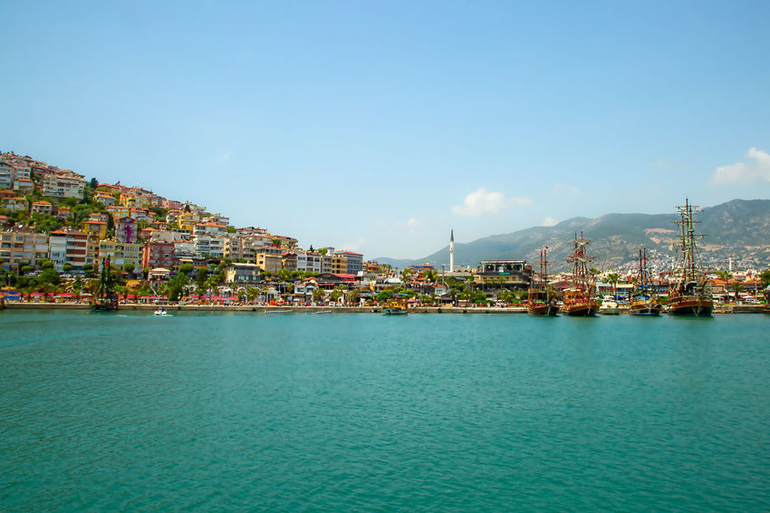 Alanya Harbor Alanya Mediterranean  Mediterranean Sea Turkey Vacation Time Architecture Blue Building Built Structure City Cityscape Emerald Green Emeraldcoast Harbor Nature Nautical Vessel Residential District Sea Shoreline Sky Transportation Travel Destinations Vacation Destination Water Waterfront