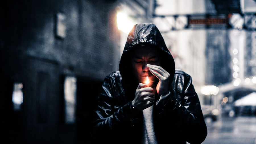 Man Lighting Cigarette With Lighter During Winter