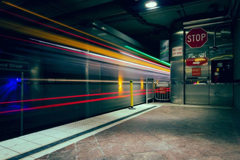 Blurred motion of train at railroad station platform during night