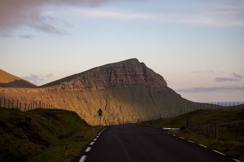 EyeEm Best Shots Tadaa Community Beauty In Nature Cloud - Sky Diminishing Perspective Direction Environment Faroe Islands Formation Landscape Marking Mountain Nature No People Non-urban Scene Outdoors Road Scenics - Nature Sign Sky Symbol The Way Forward Tranquil Scene Tranquility Transportation