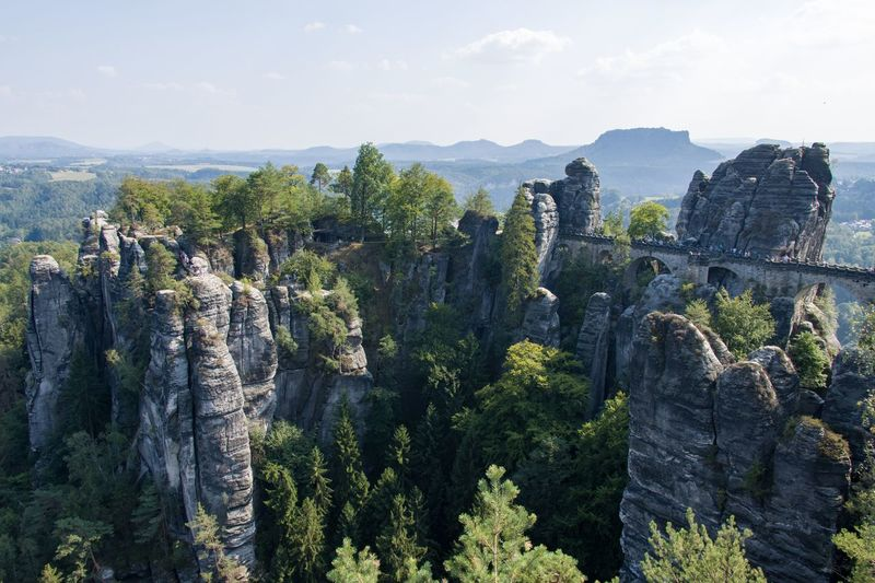 Panoramic view of trees on rock formations against sky