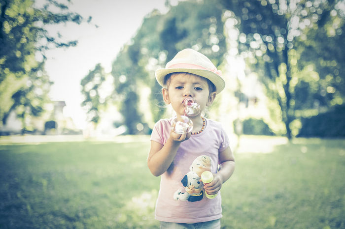 summer buble Bubble Wand Casual Clothing Childhood Close-up Cute Day Focus On Foreground Frozen Food Girls Grass Happiness Headwear Ice Cream Ice Cream Cone Leisure Activity Lifestyles Live For The Story Nature One Person Outdoors People Real People Sky Sun Hat Tree