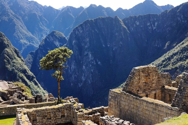 Old ruins against rocky mountains at machu picchu