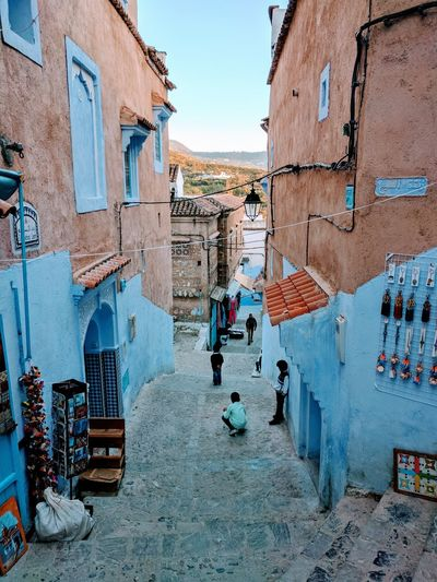 Architecture Built Structure Outdoors Building Exterior Day Sky City Ghetto Street Chaouen Chefchaouen Morocco Escape Travel Photography Traveling Chefchaouen, Morocco City Cityscape Travel Destinations History Sunset Kids Kids Playing No People