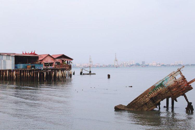 Pier in sea against clear sky