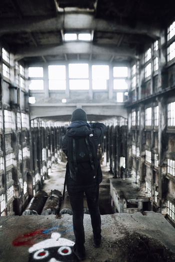 EyeEm Taking Photos Exploring Explore Check This Out Adventure City City Life Urban Exploration Backpack Full Length Lifestyles Built Structure One Person Architecture Building Day Light And Shadow Light Rear View Indoors  Damaged Deterioration Window Center