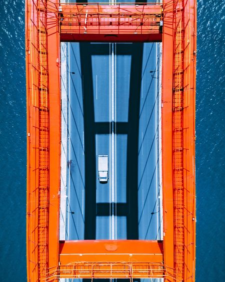 Perfectly framed Car Shadows & Lights Shadow Shadowplay Blue Bridge EyeEm Selects Architecture Built Structure No People Cargo Container Building Exterior Transportation Day Freight Transportation Water Outdoors Metal Commercial Dock Container Industry Low Angle View Orange Color Shipping  The Architect - 2019 EyeEm Awards