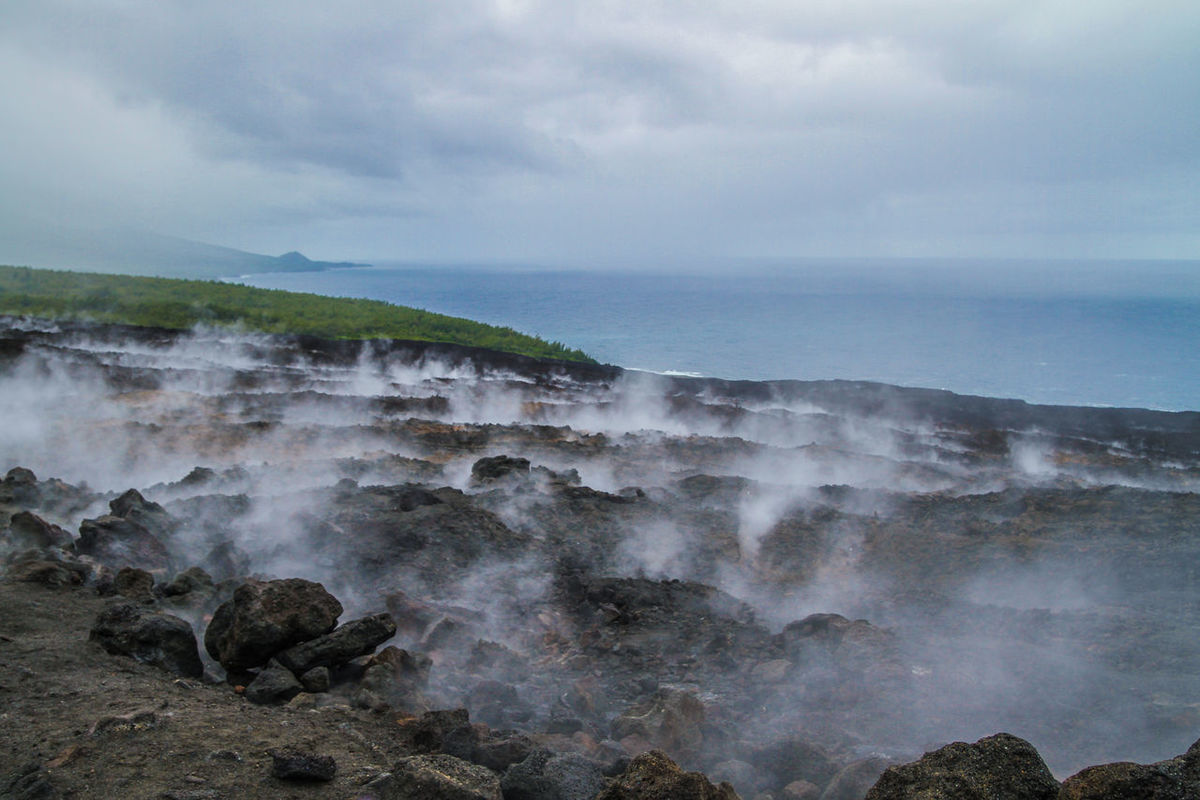 Eruption in Reunion island Beauty In Nature Eruption EyeEm RéunionIsland Fog Geology Horizon Over Water Hot Magma Motion Nature Outdoors Physical Geography Power In Nature Reunion Island Rough Scenics Sea Splashing Steam Surf Tranquil Scene Volcano Voyage Water Wave