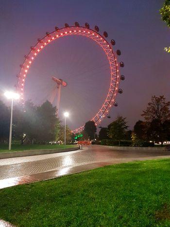 London Park Night Illuminated Ferris Wheel Outdoors