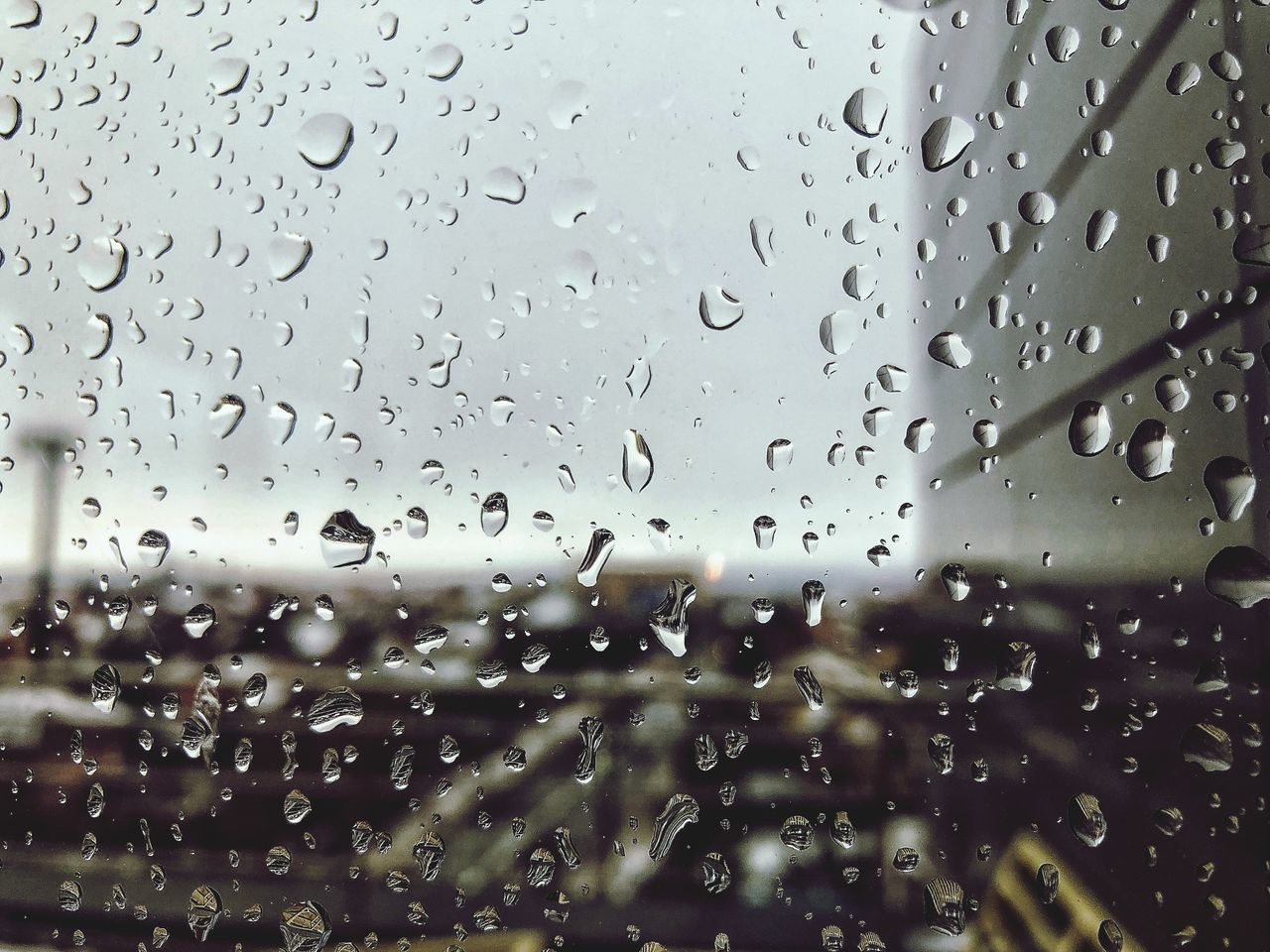 drop, wet, water, glass - material, rain, transparent, window, full frame, no people, indoors, sky, raindrop, close-up, rainy season, backgrounds, nature, focus on foreground, day, glass