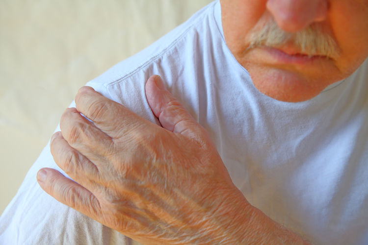 Midsection Of Senior Man Suffering From Shoulder Pain