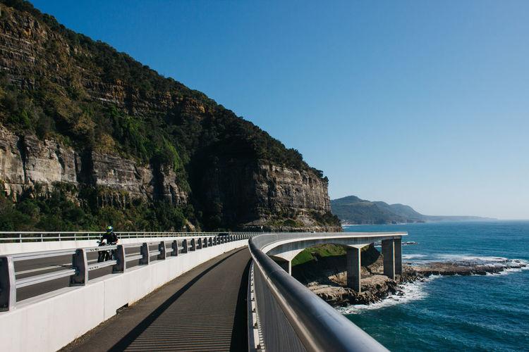 Bridge By Sea Against Clear Blue Sky