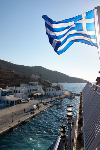 Amorgos Ferry Amorgos Architecture Blue Boat Building Exterior Built Structure City Clear Sky Day Environment Flag Greece Greece Flag Independence Katapola Mode Of Transportation National Icon Nature Nautical Vessel No People Outdoors Patriotism Sky Transportation Water Waving Wind