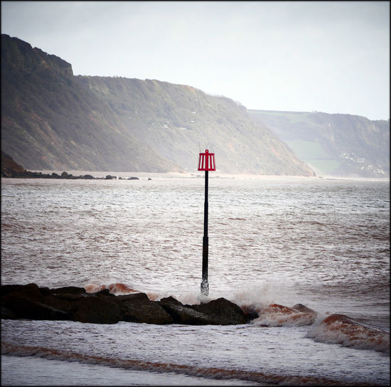 Beach Beauty In Nature Clear Sky Direction Flag Guidance Horizon Over Water Keep Off The Groynes Lighthouse Mountain Mountain Range Nature Protection Red Safety Scenics Sea Sea Spray Sidmouth Sky South Coast Tranquil Scene Tranquility Water