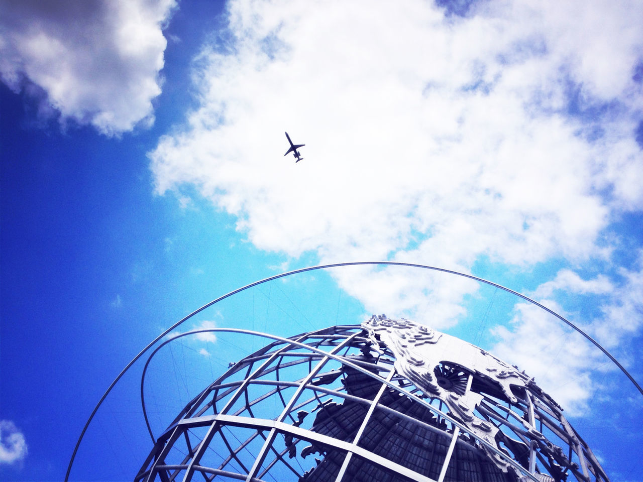 LOW ANGLE VIEW OF HELICOPTER AGAINST BLUE SKY