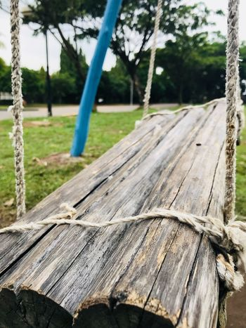 Wooden swing Wooden Swing Swing Wood - Material Outdoors Tree Rope No People Focus On Foreground Day Rope Swing Playground