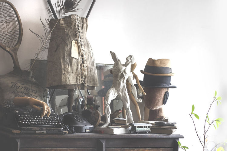 Antique Objects Antiques Art ArtWork Corset Day Hats Indoors  Large Group Of Objects No People Objects Stack Statue Tennis Racket Typewriter