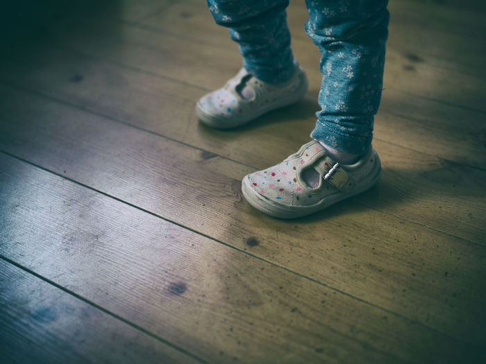 baby girl wearing sneakers Canvas Shoe Childhood Close-up Day Hardwood Floor Human Body Part Human Leg Indoors  Low Section One Person Out Of The Box People Real People Shoe Sneakers Standing Wooden Floor