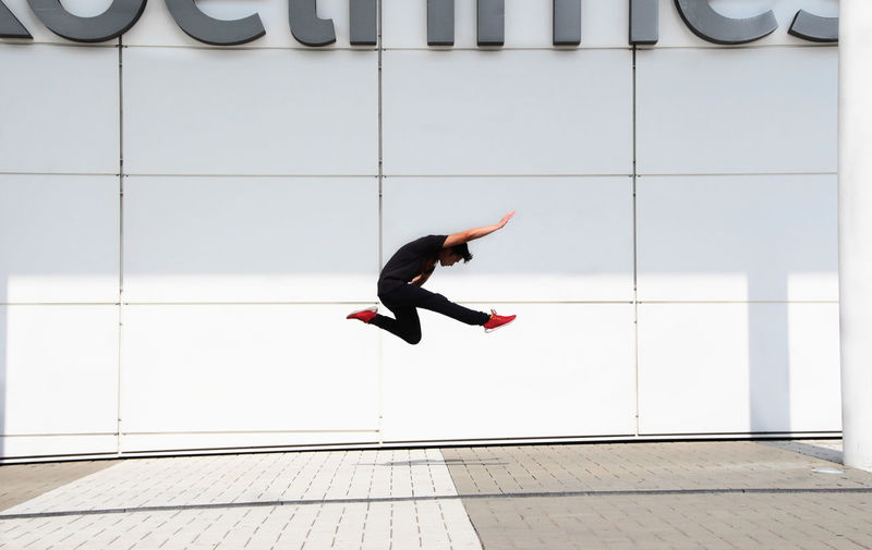 Full length of woman jumping in mid-air