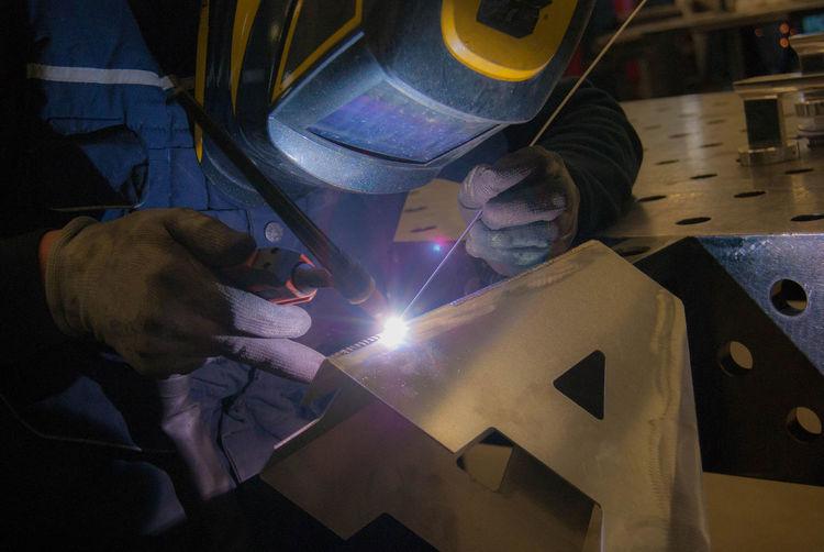 Close-up of man welding metal in workshop