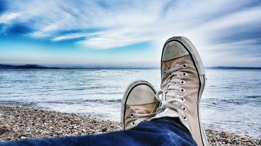 The Great Outdoors With Adobe On The Beach Relaxing Enjoying The View Shoes Allstars Seascape Sea And Sky Peace And Quiet AllStarshoes Feeling Good See What I See Seaside Sky Sea Seashore Beachphotography Beach Time My Shoes Human Body Part Human Representation Human Settlement Legs Legsselfie Take A Break