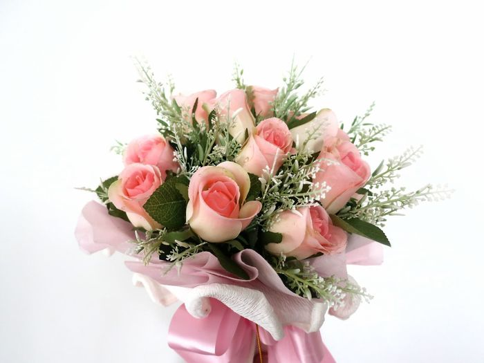 Close-up of rose bouquet against white background