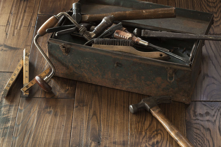 Antique tools and toolbox on dark wood surface Work Tool Metal Wood - Material Old Antique Vintage Toolbox Hammer Brace Drill Pliers Wrench  Grungy Rusty Dark Board Measuring Tool Ball Peen Screwdriver Steel Rough No People Photography Brush Latch
