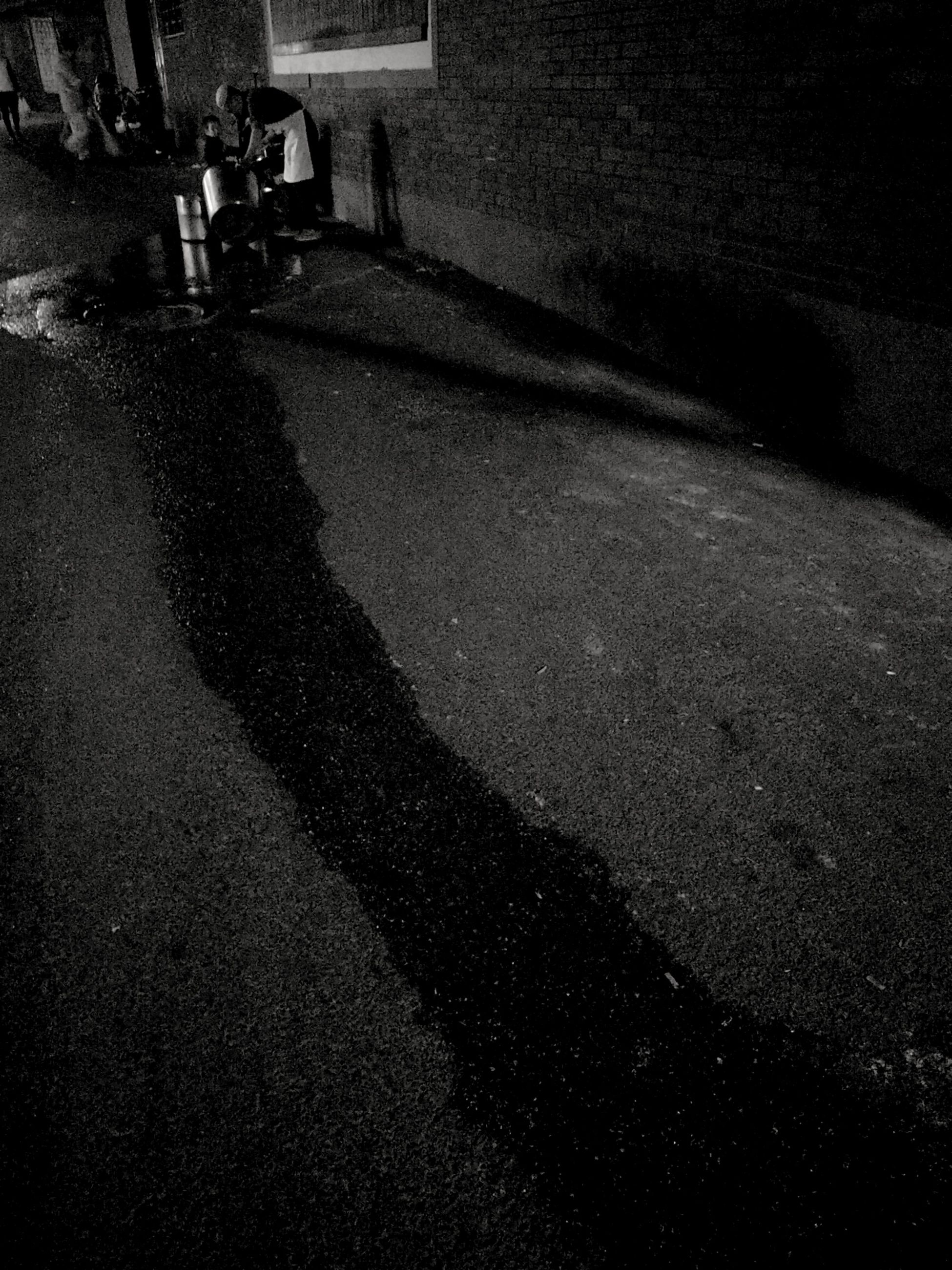 real people, lifestyles, night, walking, one person, shadow, men, outdoors, architecture, nature, people