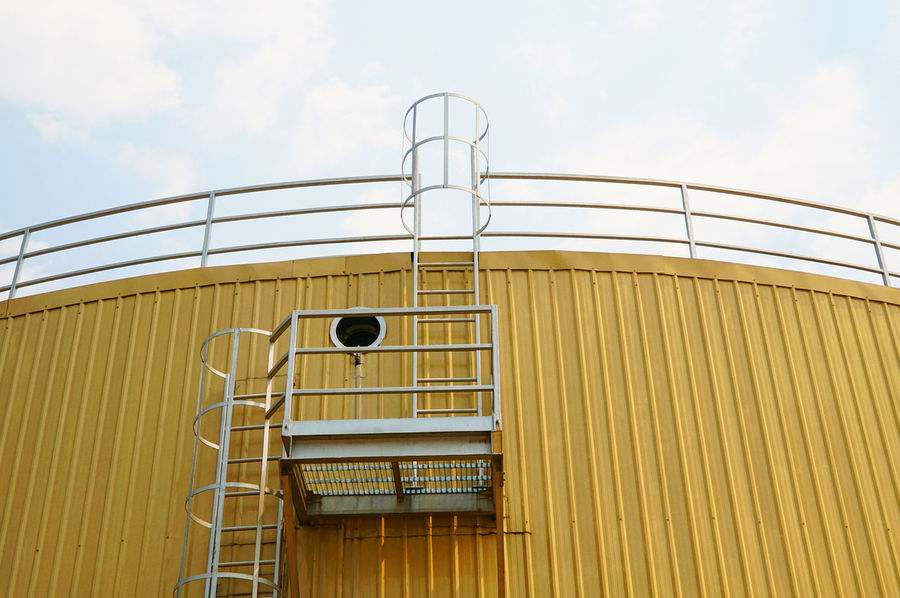Climb Container Industrial Building  Industrial Photography Architecture Building Exterior Built Structure Cloud - Sky Industrial Tank Industry Low Angle View No People Outdoors Sky Tank Vertical Ladder Yellow