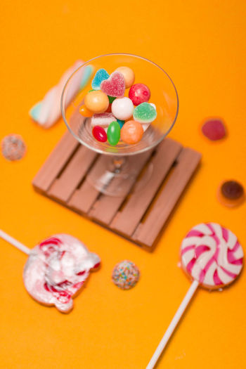 Candy Celebration Colored Background Crockery Easter Easter Egg Egg Food Food And Drink High Angle View Holiday Indoors  Indulgence Multi Colored No People Orange Background Studio Shot Sweet Sweet Food Temptation Unhealthy Eating