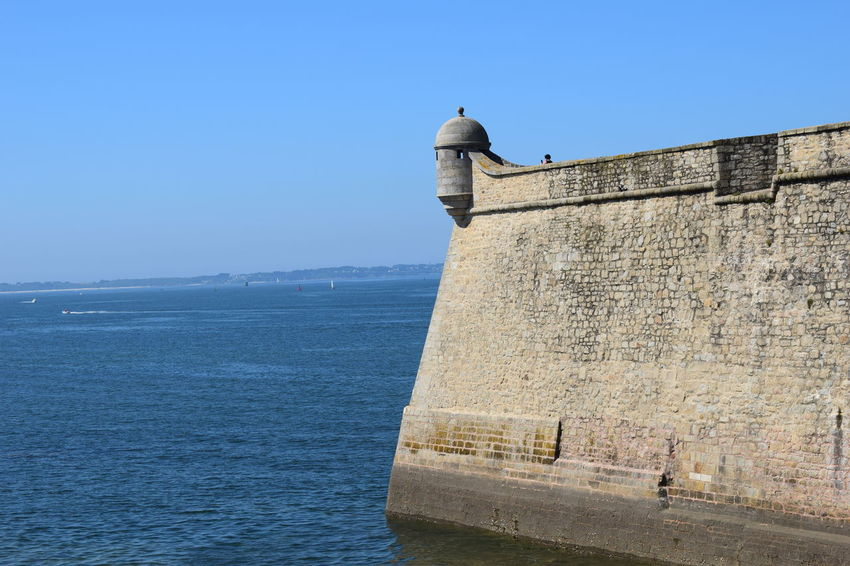 Sea port and fortress of Lorient Architecture Beauty In Nature Blue Building Exterior Built Structure Clear Sky Copy Space Day Fort History Horizon Over Water Nature No People Outdoors Scenics - Nature Sea Sky Stone Wall The Past Vertebrate Wall Water