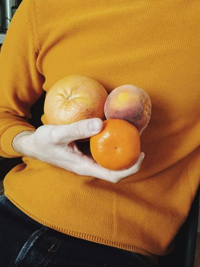 Hand Holding Fruit
