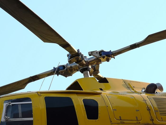 helicopter and rotor blades Clear Sky Helicopter Air Vehicle Clear Sky Day Heli Helicopter Mode Of Transportation No People Outdoors Rotor Blade Rotor Blades Sky Transportation Yellow