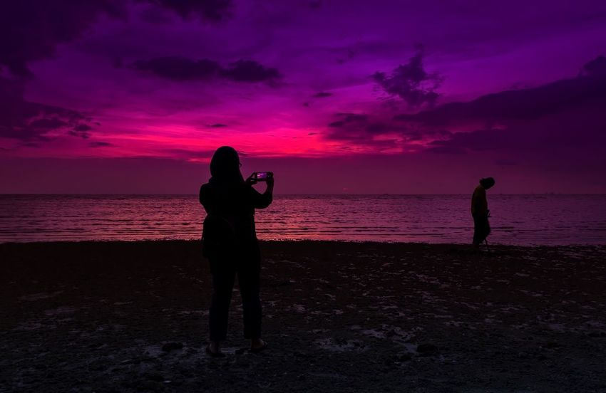 Taking photos Sunset Silhouette Beach Sky Full Length Lifestyles Night Two People Standing Scenics Beauty In Nature Horizon Over Water Vacations Outdoors Sea The Traveler - 2018 EyeEm Awards