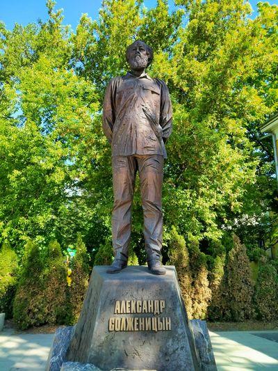 Statue against trees