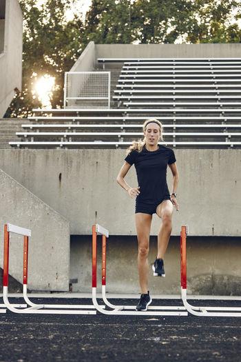 Full length portrait of woman running