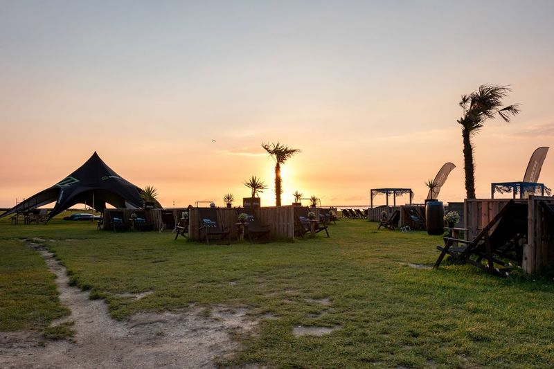 Neuharlingersiel, North Germany Sunset Outdoors Nature Sky Grass No People Tree Tranquility Beauty In Nature Palm Tree Day Beach Beachbar