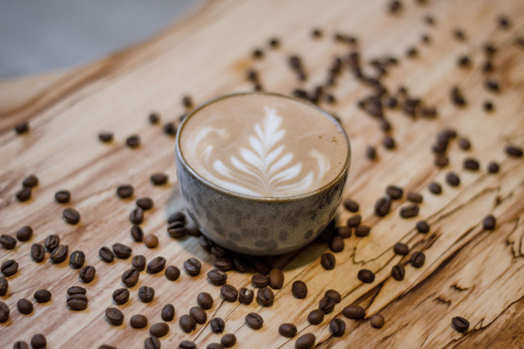 Coffee Coffee - Drink Coffee Cup Coffee Time Coffee Break Food And Drink Indoors  No People Drink Refreshment Wood - Material Freshness Cappuccino Food Focus On Foreground Roasted Coffee Bean Close-up Still Life Latte Mug Table Hot Drink Frothy Drink Non-alcoholic Beverage
