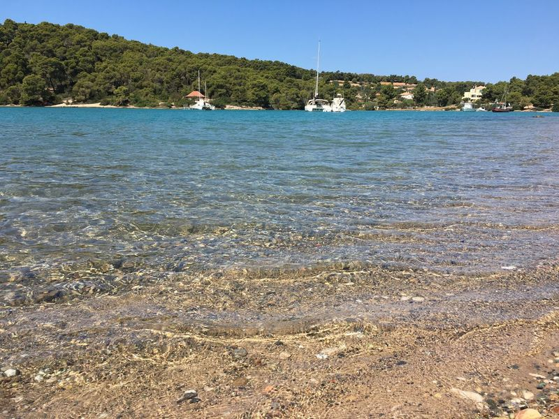Travel Destinations Greece Porto Heli Porto Cheli Water Nature Sky Land Beach Sea Day Tranquility Beauty In Nature Tranquil Scene Scenics - Nature Sunlight Clear Sky Waterfront Idyllic