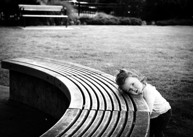 Reflections of a child kind Childhood One Person Child Day Real People Bench Park Girls Focus On Foreground Park - Man Made Space Seat Females Innocence Outdoors