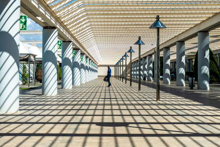Side View Of Mature Man Standing On Footbridge