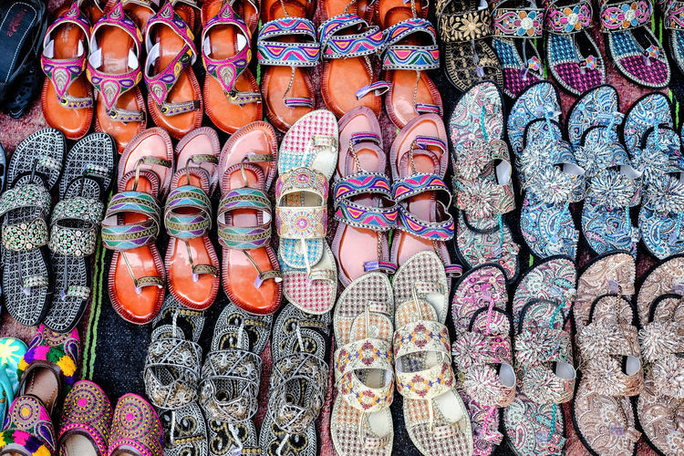 Ladies Shoes Fashion Retail  Market For Sale Choice Variation Shoes Traditional Shoes Street Market Consumerism Pattern Sale Business In A Row Retail Display Art And Craft Abundance Store Market Stall Multi Colored Arrangement Souveniers Pakistan Shoe Shop