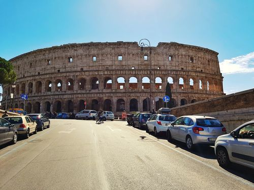 Architecture Built Structure Building Exterior Car Old Ruin Transportation History Travel Travel Destinations Clear Sky Arch Tourism Land Vehicle The Past Famous Place Mode Of Transport Ancient Ancient Civilization Archaeology Outdoors Rome Rome Italy🇮🇹 Coluseum Colosseum Moving Around Rome