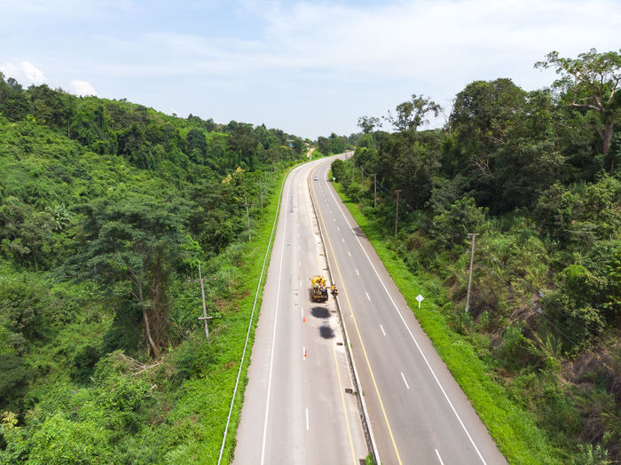 High angle view of highway amidst trees in forest