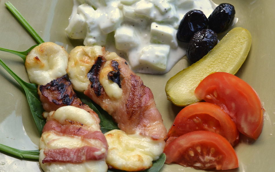 Grilled Bacon Wrapped Haloumi Cheese with cucumber salad, tomato wedges, black olives and dill pickle: close-up, selective focus Atkin's Diet Dinner Keto Lunch Bacon Wrapped Close-up Closeup Dairy Product Food Food And Drink Freshness Haloumi Cheese Healthy Healthy Eating High Angle View Keto Diet Ketogenic Ketogenic Diet Food Ketogenic Meal Low Carb Meal Low Carbohydrate Meal Organic Ready-to-eat Still Life Wellbeing